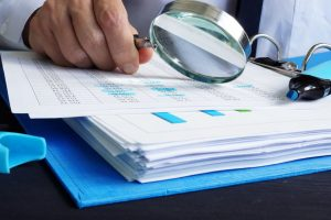 Auditor is working with financial documents